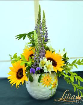 Arrangement with lupins and sunflowers